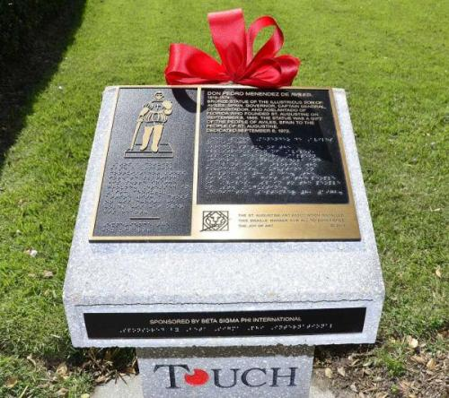 A new marker in front of the Lightner Building in St. Augustine gives a description of the statue in English and in Braille.