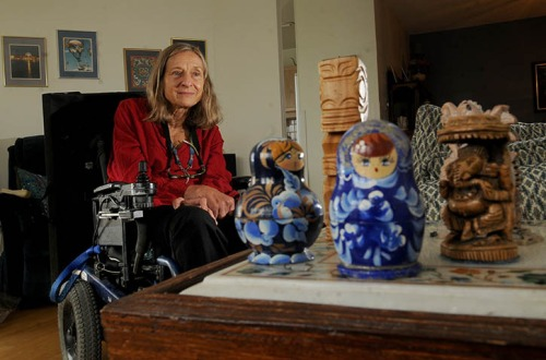 Linda McGowan has collected various trinkets from her travels around the world, including Russian Matryoshka dolls and tikis from Indonesia