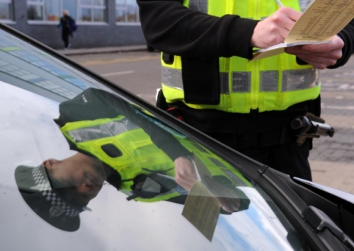 Pc Daniel Halliday tickets a motorist parked in a disabled parking bay at the Lasswade Centre.