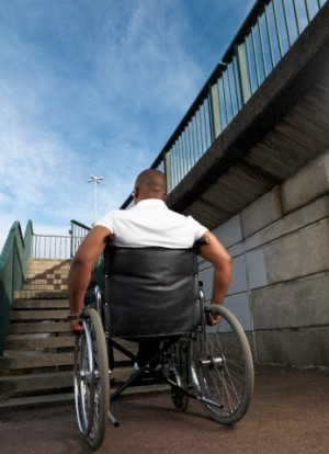 Man in wheelchair in front of steps