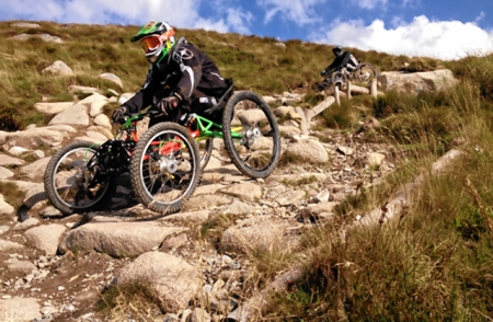 A four-wheeled bike being put through its paces on a mountain bike track in Fort William