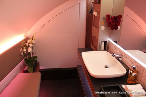 A first class lavatory on a Qatar A380. Although helpful, it wouldn't make financial sense for restrooms to be this large.