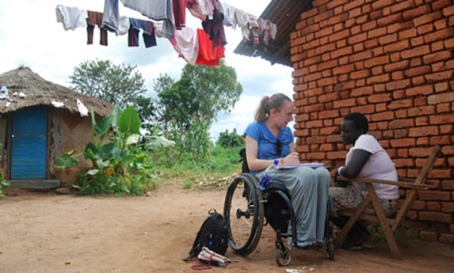 Lucy Robinson working in Uganda with Vitality, the charity she set up to help carers of people with spinal cord injuries