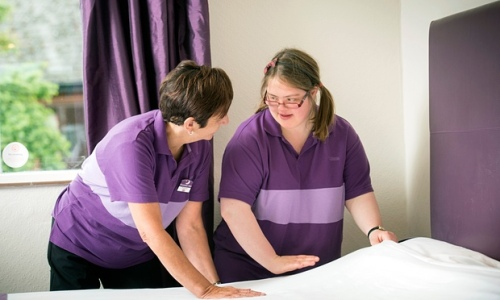 Claire Brunt, 24, learns how to make beds in a Premier Inn at Shropshire's Derwen College with her tutor Yvonne Daniel Photograph Adrian Sherratt