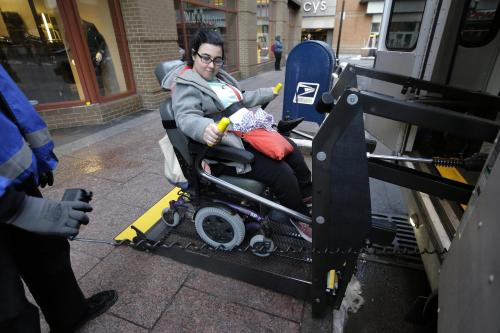 With a limited number of wheelchair-accessible vehicles, the ride-hailing services would be available largely to people who can walk
