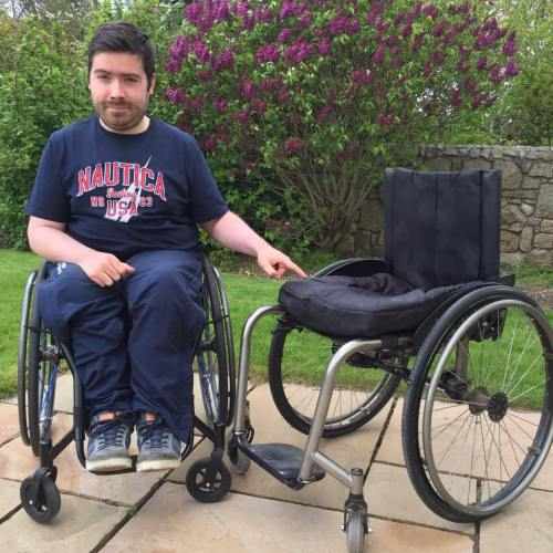 A young man has launched a campaign urging people to spend a day in a wheelchair following a series of difficulties he experienced on a train.