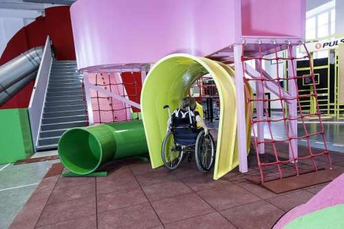 A young wheelchair user taking part in an obstacle course at the MegaMind science centre in Sweden's National Museum of Science and Technology