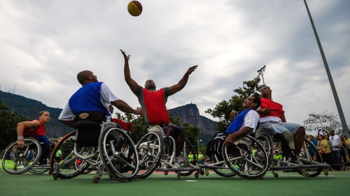 Brazilian Paralympic athletes play basketball in wheelchairs during an event celebrating one year until the start of the Rio 2016 Paralympic Games