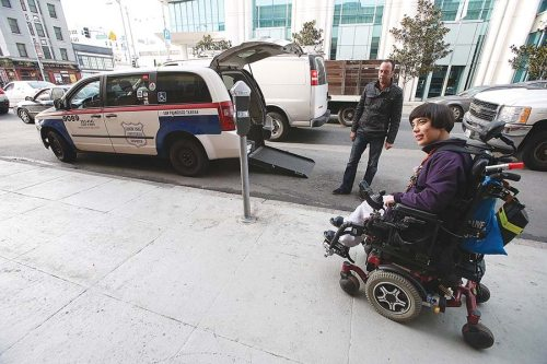 fiona-hinze-right-is-pictured-with-luxor-cab-paratransit-driver-giovanni-favognano-on-howard-street-in-january-2015